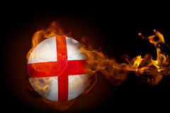 Fire surrounding england ball. Composite image of fire surrounding england ball against black Stock Photography