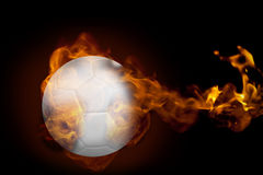 Fire surrounding football. Composite image of fire surrounding football against black Stock Photo