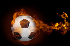 Fire surrounding football. Composite image of fire surrounding football against black Royalty Free Stock Image