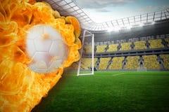 Fire surrounding football Royalty Free Stock Photos