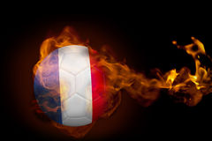 Fire surrounding france ball. Composite image of fire surrounding france ball against black Stock Photo