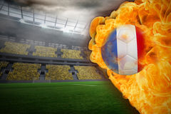 Fire surrounding france flag football. Composite image of fire surrounding france flag football against large football stadium with lights Stock Photos
