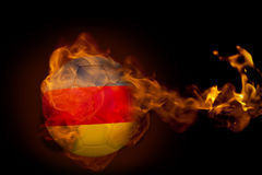 Fire surrounding germany ball Royalty Free Stock Photos
