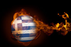 Fire surrounding greece ball. Composite image of fire surrounding greece ball against black Royalty Free Stock Images