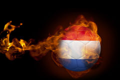 Fire surrounding holland ball. Composite image of fire surrounding holland ball against black Royalty Free Stock Image