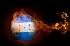 Fire surrounding honduras ball. Composite image of fire surrounding honduras ball against black Royalty Free Stock Photos