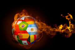 Fire surrounding international flag football. Composite image of fire surrounding international flag football against black Royalty Free Stock Photo