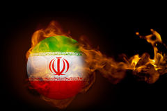 Fire surrounding iran ball. Composite image of fire surrounding iran ball against black Royalty Free Stock Photo