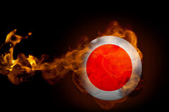 Fire surrounding japan ball. Composite image of fire surrounding japan ball against black Stock Images