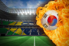 Fire surrounding korea republic flag football Royalty Free Stock Photos