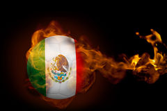 Fire surrounding mexico ball. Composite image of fire surrounding mexico ball against black Stock Photo