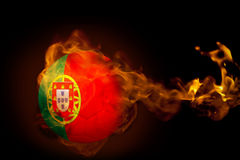 Fire surrounding portugal ball Royalty Free Stock Photography