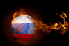 Fire surrounding russia ball. Composite image of fire surrounding russia ball against black Stock Image