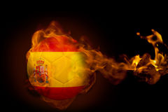 Fire surrounding spain ball. Composite image of fire surrounding spain ball against black Stock Photo