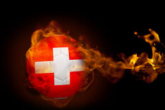 Fire surrounding switzerland ball Stock Images