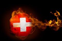 Fire surrounding switzerland ball Stock Images