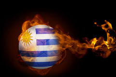 Fire surrounding uruguay ball. Composite image of fire surrounding uruguay ball against black Royalty Free Stock Photos