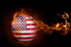 Fire surrounding usa ball. Composite image of fire surrounding usa ball against black Royalty Free Stock Photography