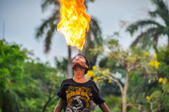 Fire-swallower boy in Jakarta, Indonesia Royalty Free Stock Image