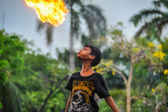 Fire-swallower boy in Jakarta, Indonesia Royalty Free Stock Photography