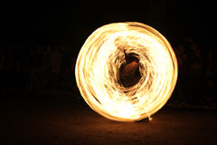Fire swirl. Swirling fire effect  of man with juggling torches Stock Images