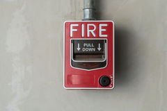 Fire switch on wall Stock Photography