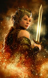 Fire Sword, 3d CG. 3D computer graphics of a female warrior with fantasy dress and sword Royalty Free Stock Images