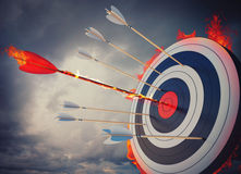Fire target. Flaming arrow hitting the center of target royalty free stock photo