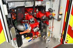 Fire tenders hose pumping system Stock Photo