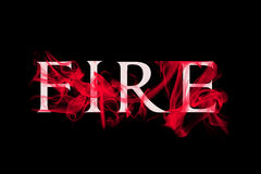 Fire text with flames. Fire concept with white fire text on red flames on black background Royalty Free Stock Photography