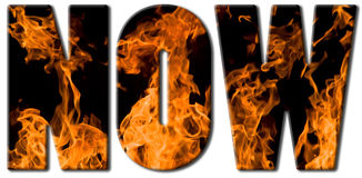 Fire text - now. Now text filled with an image of massive heap of hot flames Stock Image