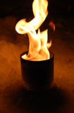 Fire in a tin can. In snow Royalty Free Stock Images