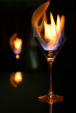 Fire tongue and glass reflected Royalty Free Stock Images