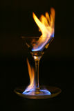 Fire tongue inside and around glass. Fire tongue inside and around medium martini glass Royalty Free Stock Image