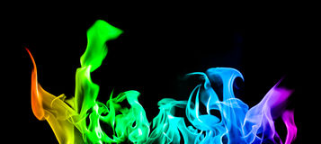 Fire tongues. Long colorized fire shot in panorama format Royalty Free Stock Image