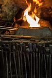 Fire and tool in blacksmiths forge Stock Photos
