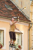 Fire torch juggler performing during Spancirfest festival Stock Image