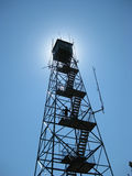 Fire Tower in the Sun. Brown county Indiana fire tower in from of the sun royalty free stock photo