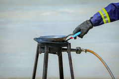 Fire trainer hand,how to ignite or light gas at stove for confla Royalty Free Stock Image