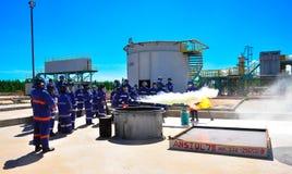 Fire training team using extinguish stock photos