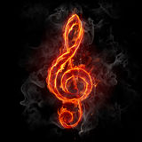 Fire treble clef. Fiery musical symbol on black background. Series of fiery illustrations Royalty Free Stock Photography