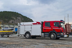 Fire truck. (emergency vehicle) on exercise at the quay on the port of Halden Stock Photo