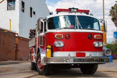 Fire Truck. A Shiny Red Fire Truck In Action Outdoor Stock Images