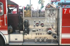 Fire Truck. A Fire Truck controls parked outside a firehouse royalty free stock photos
