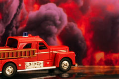 Fire truck. A fire truck with a fire in the background Royalty Free Stock Images