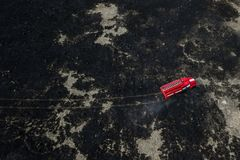 Fire truck on fire aerial view stock images