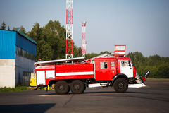 Fire truck in the airport. Big red fire engine sunny day Royalty Free Stock Images