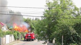 Fire truck arrives on fire. KIEV, UKRAINE - 07 18 2017 Fire truck arrives on fire stock video
