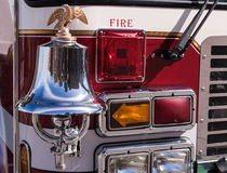 Fire Truck Bell, Eagle, Bull Dog and Lights. Bright chrome and brass bell on the front of a fire truck and front lights Royalty Free Stock Images