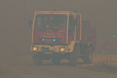 Fire Truck changing position on Wildfire Stock Photo